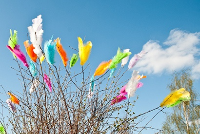 Colorful feathers are attached to plants during Easter